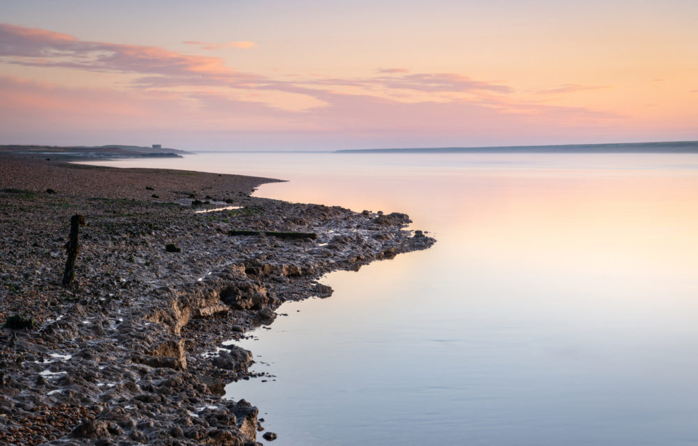 Silver and pink skies over a calm river