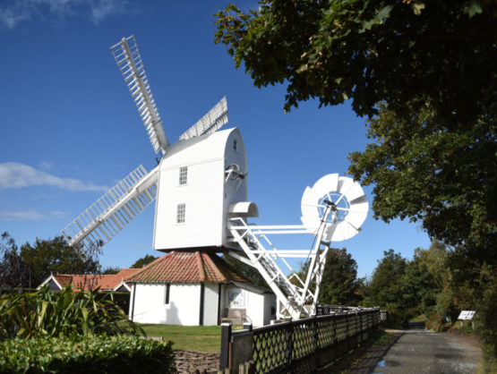 A windmill at Thorpeness up against a blue sky