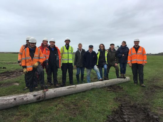 Workers standing by last removed pole