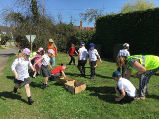 Group of school children participating in wildflower day