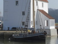 View of Tide Mill with boat in foreground