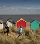 Woman and children in front of beach houses